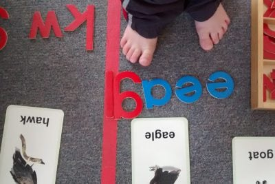 student using wooden letters and cards